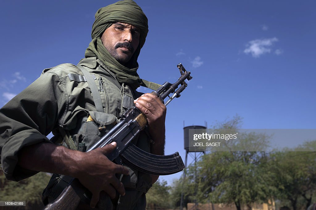Malian army Tuareg, Aghali Ag Aga, aged 24, holds an AK-47 assault rifle on February 25, 2013 in Gao, some 1,200 kilometres (745 miles) north of Bamako. After recapturing the north's cities from the Al Qaeda groups that had controlled them since April 2012, the six-week-long French-led offensive took the fight to the retreating Islamist insurgents' toughest desert bastions.