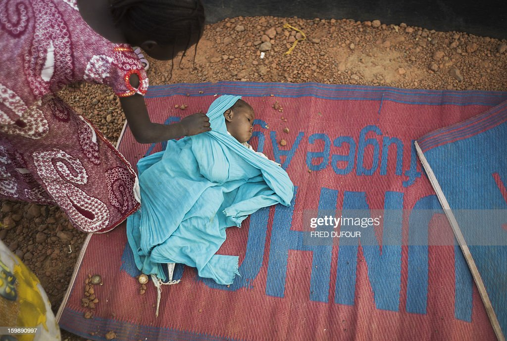 A Malian baby sleeps on a mat inside a camp for internally displaced persons (IDPs) in Sevare, on January 22, 2013. Mali's army chief today said his French-backed forces could reclaim the northern towns of Gao and fabled Timbuktu from Islamists in a month, as the United States began airlifting French troops to Mali.
