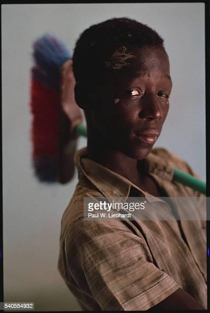 Malian Boy Holding a Broom