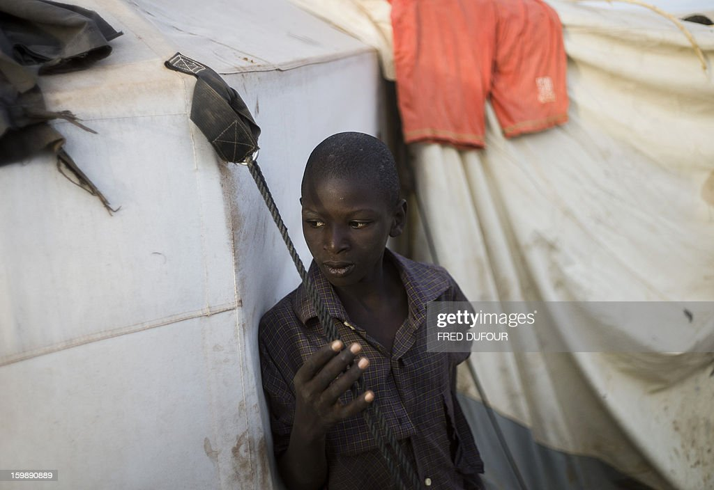 A Malian boy who fled northern Mali stands near a tent at a camp for internally displaced persons (IDPs) in Sevare, on January 22, 2013. Mali's army chief today said his French-backed forces could reclaim the northern towns of Gao and fabled Timbuktu from Islamists in a month, as the United States began airlifting French troops to Mali.