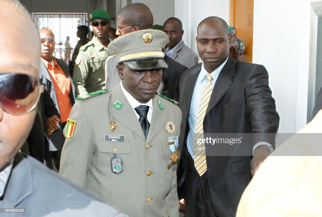 Malian captain Amadou Haya Sanogo (C), head of the coup forces that overthrew Malian President Amadou Toumani Toure in 2012, arrives for an official investiture ceremony in Koulouba on February 13, 2013 after being named six months ago at the head of a commitee for the reform of the Malian armed forces. AFP PHOTO /