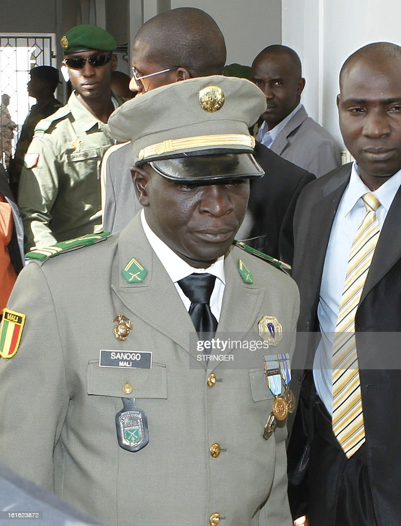 Malian captain Amadou Haya Sanogo (C), head of the coup forces that overthrew Malian President Amadou Toumani Toure in 2012, arrives for an official investiture ceremony in Koulouba, outside Bamako, on February 13, 2013. Captain Amadou Sanogo was sworn as head of a military reform committee, a post created for him as an incentive to accept a transitional government tasked with steering the country to elections, by interim president Dioncounda Traore in a ceremony at the presidency. AFP PHOTO / STRINGER