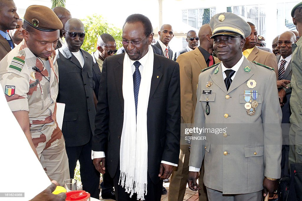 Malian captain Amadou Haya Sanogo (C), head of the coup forces that overthrew Malian President Amadou Toumani Toure in 2012, arrives for an official investiture ceremony in Koulouba, outside Bamako, on February 13, 2013. Captain Amadou Sanogo was sworn as head of a military reform committee, a post created for him as an incentive to accept a transitional government tasked with steering the country to elections, by interim president Dioncounda Traore in a ceremony at the presidency.