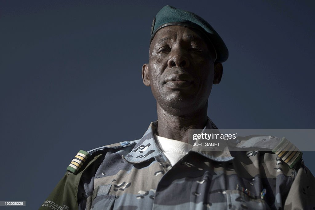 Malian chief of Gao's gendarmerie district, Colonel Salhiou Maiga poses in the office of the Gao's gendarmerie in Gao on February 24, 2013. After recapturing the north's cities from the Al Qaeda groups that had controlled them since April 2012, the six-week-long French-led offensive took the fight to the retreating Islamist insurgents' toughest desert bastions.