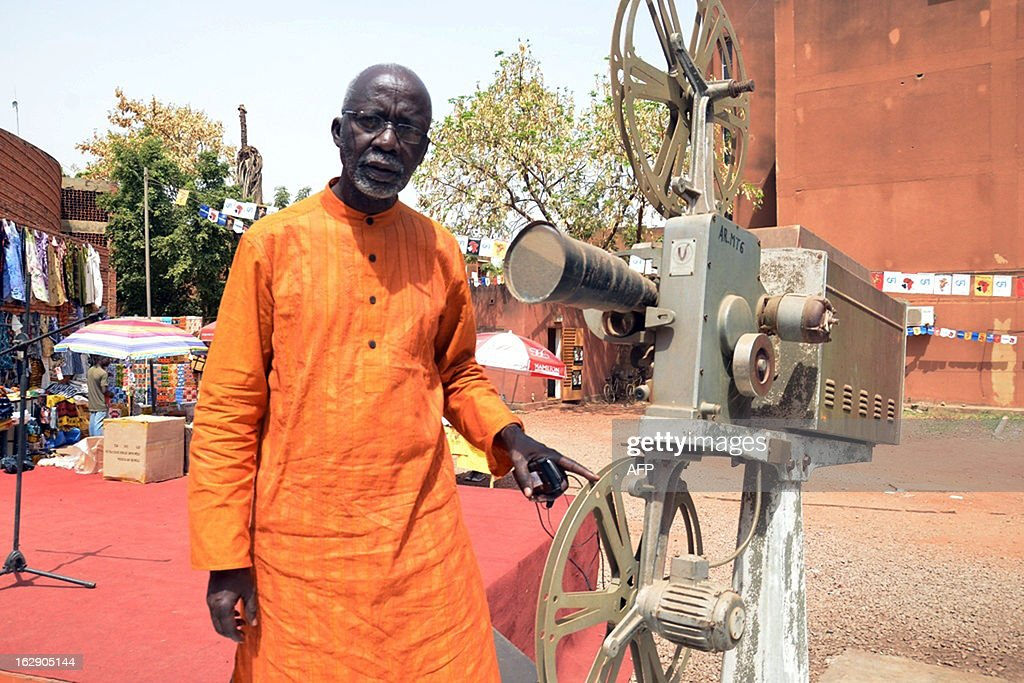 Malian director Souleymane Cisse poses next to an old camera on March 1, 2013 during the Fespaco cinema festival in Ouagadougou. Africa's biggest film festival Fespaco opened its 23rd edition in Burkina Faso's capital Ouagadougou on February 24, with 101 films vying for the top Etalon d'Or prize.