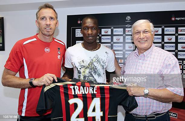 Malian football player Abdou Traore poses with Nice's coach Eric Roy andpresident Gilbert Stellardo prior to a press conference on September 1 2010...