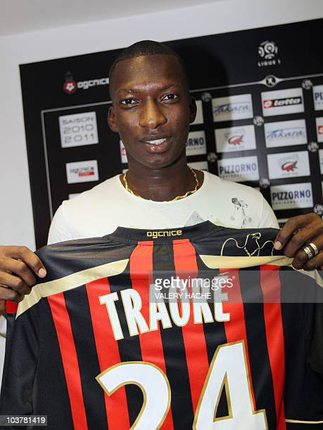 Malian football player Abdou Traore presents his new jersey during a press conference on September 1 2010 in Nice following his transfert from...