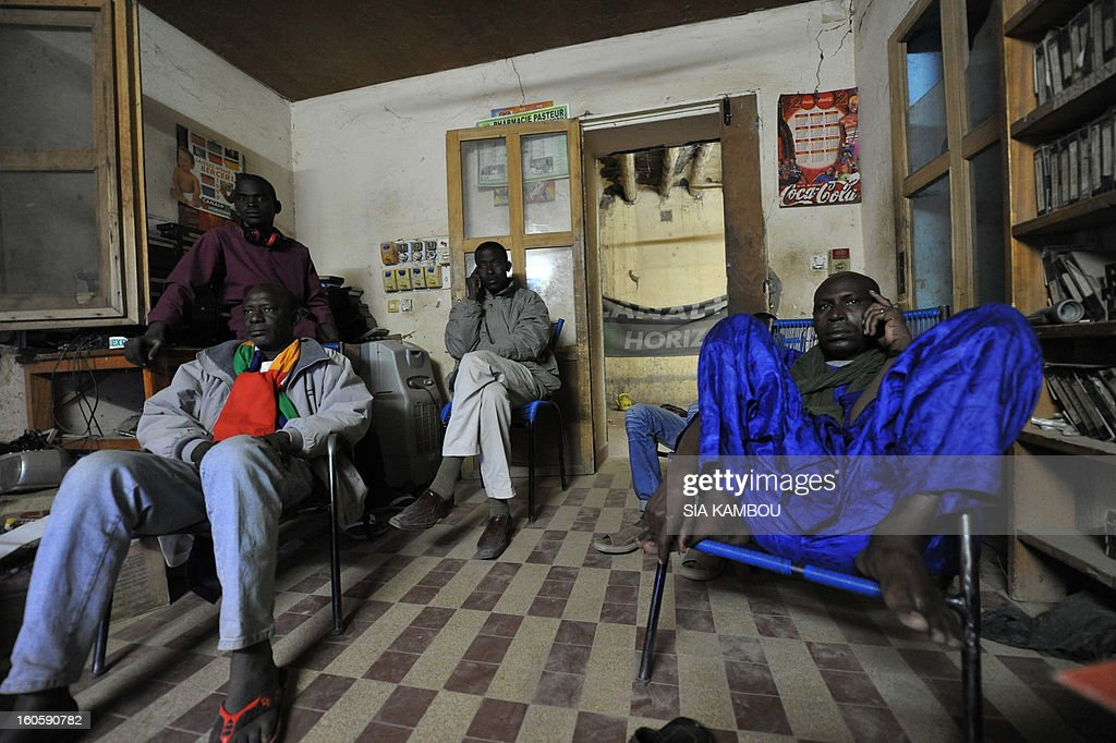 Malian football team supporters watch on a TV screen, on February 2, 2013 in Gao, the African Cup of Nation 2013 quarter final football match South-Africa vs Mali.