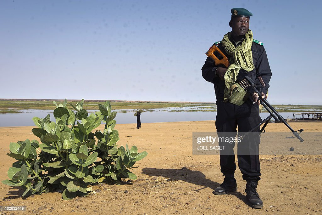 Malian gendarme Adama Yaya, 28 years old, is pictured near the Niger river on February 28, 2013 in the northern Mali's largest city Gao. AFP PHOTO /JOEL SAGET