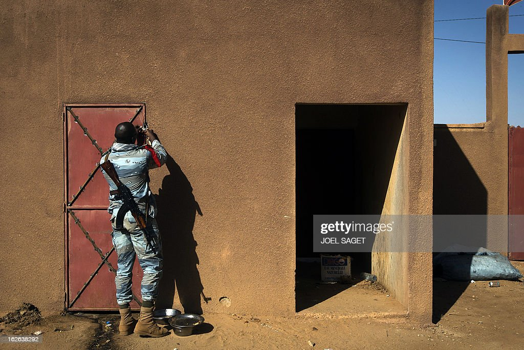 A Malian gendarme locks a door of an improvised jail on February 24, 2013 in the office of the gendarmerie in Gao. After recapturing the north's cities from the Al Qaeda groups that had controlled them since April 2012, the six-week-long French-led offensive took the fight to the retreating Islamist insurgents' toughest desert bastions. AFP PHOTO /JOEL SAGET