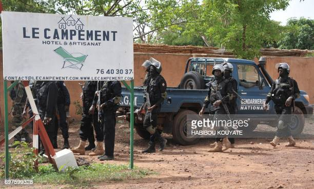 Malian gendarmes and members of antiterrorist special forces 'Forsat' arrive at the entrance of the Kangaba tourist resort in Bamako on June 19 a day...