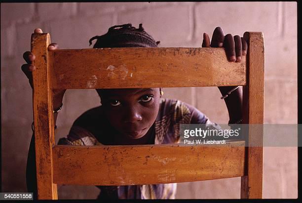 Malian Girl Leaning on Chair