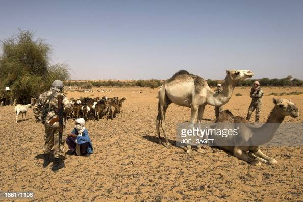 A Malian mas is questioned by a Malian soldier during the Operation Gustav a hunt for Islamist fighters in a valley in northern Mali and one of...
