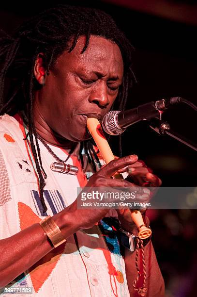 Malian musician Habib Koite plays a pennywhistlelike instrument on the Acoustic Africa Tour at BB King Blues Club Grill in Times Square New York New...