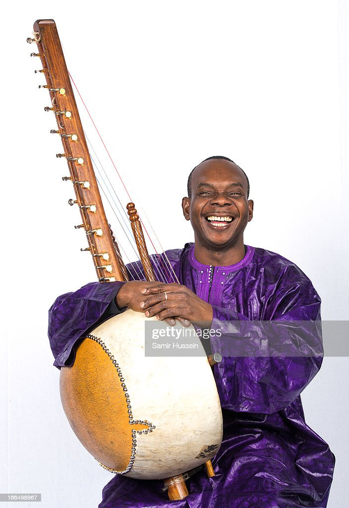 Malian musician <a gi-track='captionPersonalityLinkClicked' href=/galleries/search?phrase=Toumani+Diabate&family=editorial&specificpeople=828405 ng-click='$event.stopPropagation()'>Toumani Diabate</a> poses for a portrait session on April 12, 2013 in London, England.