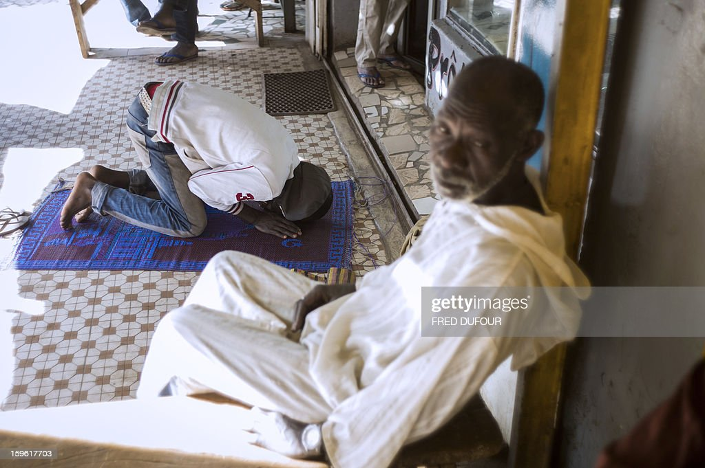 A Malian Muslim man prays in Bamako, on January 17, 2013. Forty Togolese soldiers arrived in Mali today, the first of those pledged by African nations to back a French-led offensive against Islamist rebels. West African troops have promised more than 3,000 soldiers to back Operation Serval, launched on January 11.