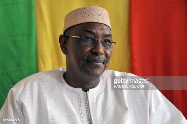 Malian newly appointed Prime Minister Abdoulaye Idrissa Maiga looks on during the the handover ceremony in Bamako on April 10 2017 two days after his...