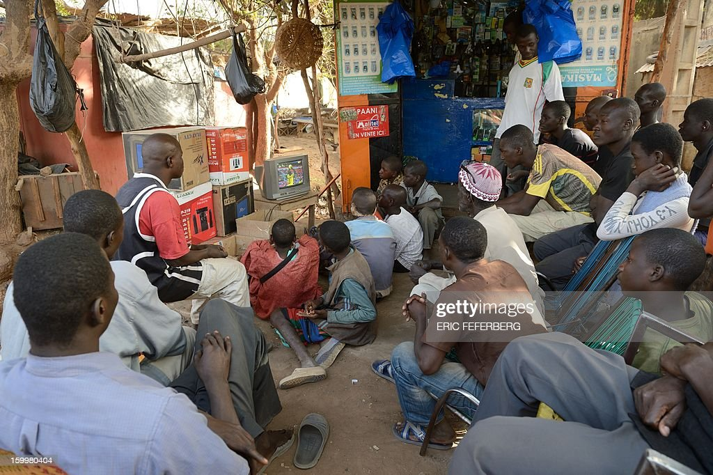 Malian people look at 2013 Africa Cup of Nations football match Ghana vs Mali in a shop of Segou on January 24,2013.