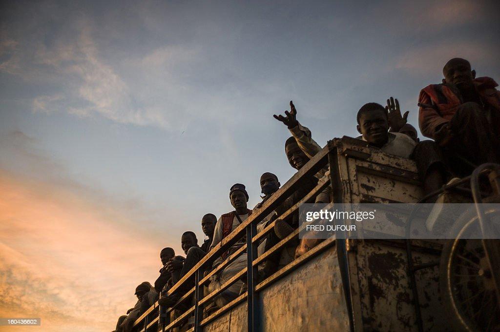 Malian people travel in a truck on January 29, 2013 in San, a Malian town near the border with Burkina Faso.