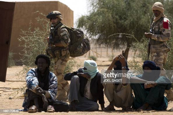 Malian people wait to be questioned by Malian and French soldiers during the Operation Gustav a hunt for Islamist fighters in a valley in northern...