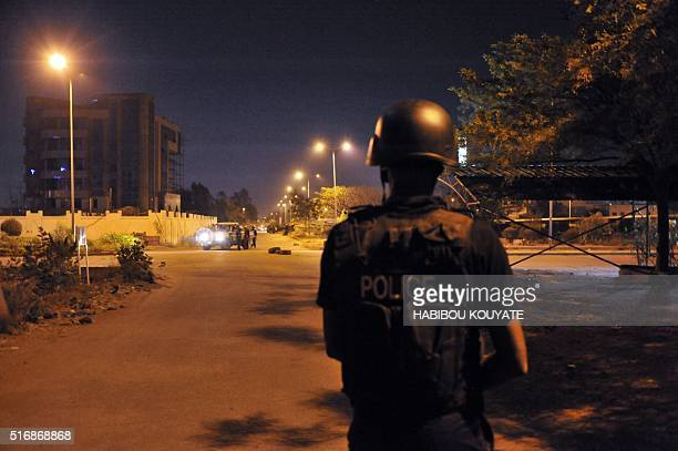 TOPSHOT Malian police officers patrol in a street during an attack targeting a hotel hosting an EU military training mission in Bamako on March 21...