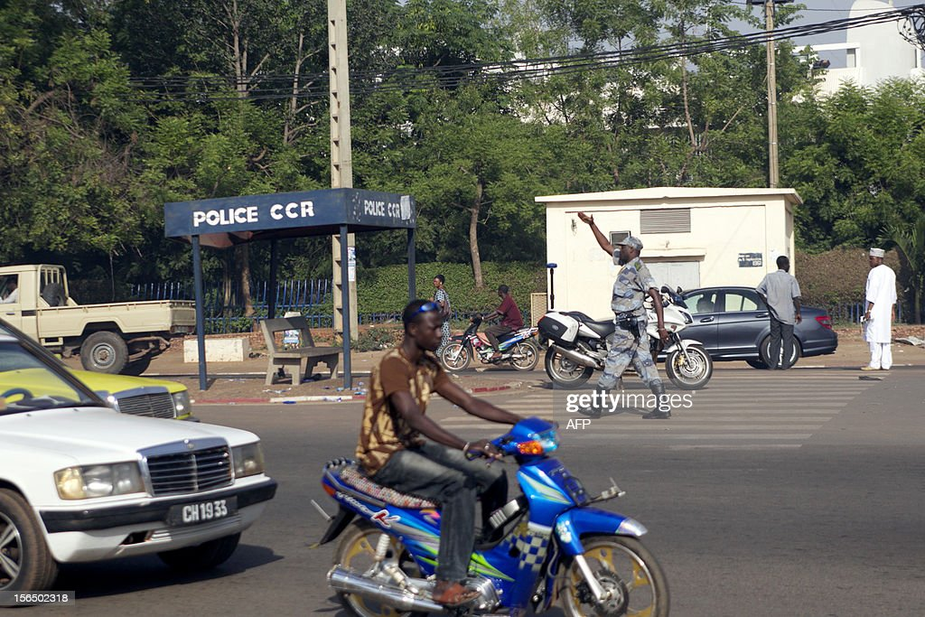 A Malian policeman regulates traffic in Bamako on November 16, 2012. Three police officers were kidnapped on November 15 to protest against an array of controversial promotions.