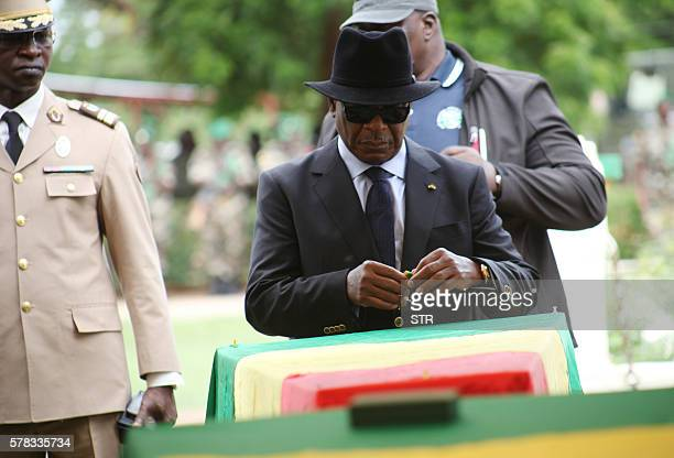 Malian president Ibrahim Boubacar Keita attends a funeral ceremony on July 21 2016 in Segou Mali announced on July 21 it had opened an investigation...