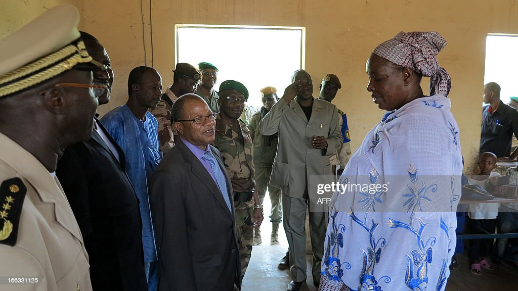 Malian Prime Minister Django Cissoko (3rd L) visits a classroom at Farandjiraye school in Gao on April 11, 2013