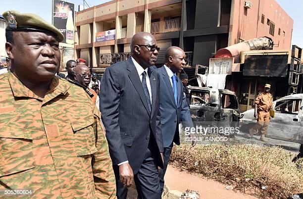 Malian Prime Minister Modibo Keita and Burkina Faso's Prime Minister Paul Kaba Thieba walk towards caferestaurant Capuccino after visiting the...