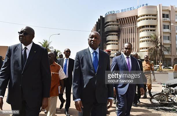 Malian Prime Minister Modibo Keita Burkina Faso's Prime Minister Paul Kaba Thieba and Burkina Faso's foreign Minister Alpha Barry leave after...
