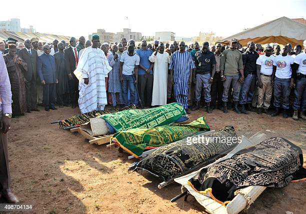 Malian Prime Minister Modibo Keita stands next to Malian President Ibrahim Boubacar Keita attend the funerals of five of the victims of last week's...