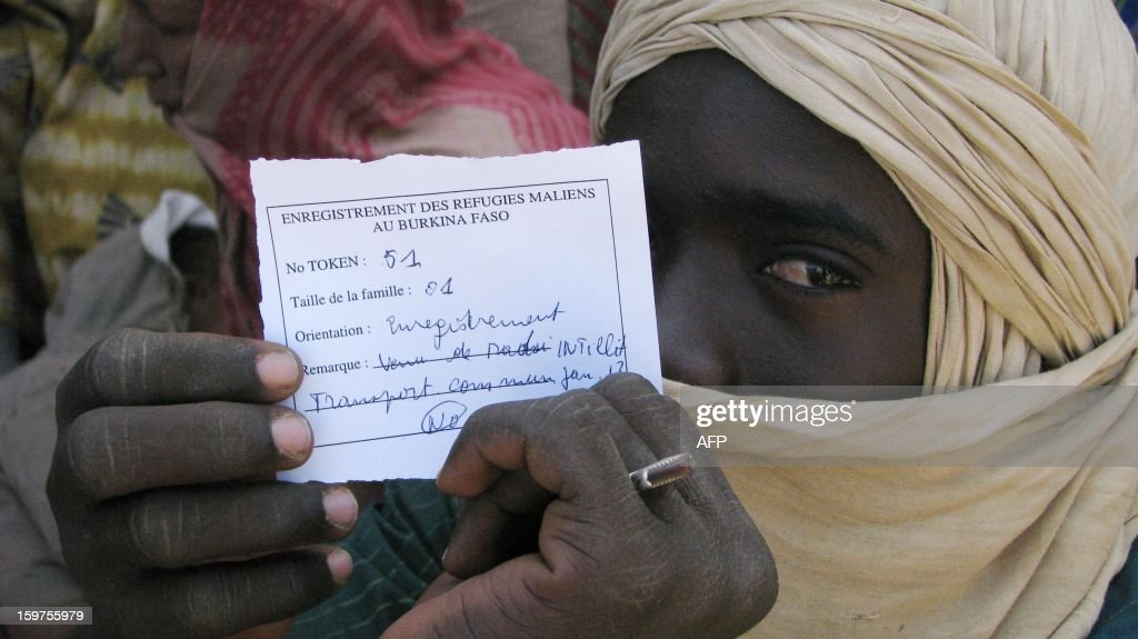 A Malian refugee shows a document at Burkina Faso's Goudebou camp on January 19, 2013, northern Burkina-Faso. The conflict in Mali has caused nearly 150,000 people to flee the country, while about another 230,000 are internally displaced, the UN humanitarian agency said on January 15, 2013. According to OCHA, the UN High Commissioner for Refugees has registered 144,500 refugees in neighbouring countries -- 54,100 in Mauritania, 50,000 in Niger, 38,800 in Burkina Faso and 1,500 in Algeria.