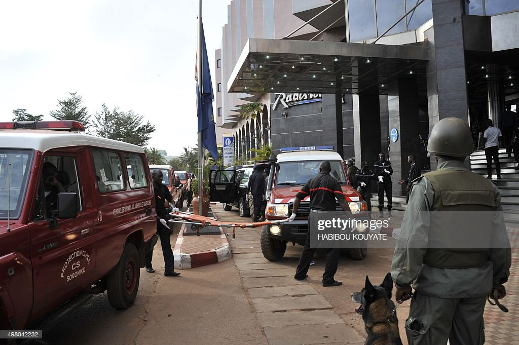 Malian rescuers soldiers and special forces are pictured at the entrance the Radisson Blu hotel in Bamako on November 20 after the assault of...