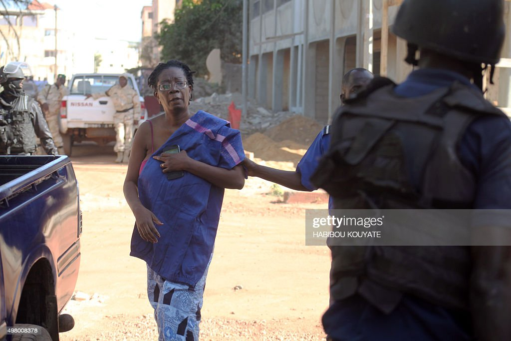 Malian security forces escort a hostage freed from the Radisson Blu hotel in Bamako on November 20 2015 Gunmen went on a shooting rampage at the...