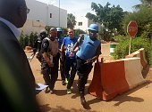 Malian security forces escort a hostage freed from the Radisson Blu hotel in Bamako on November 20 2015 Gunmen have taken 170 hostages at Radisson...
