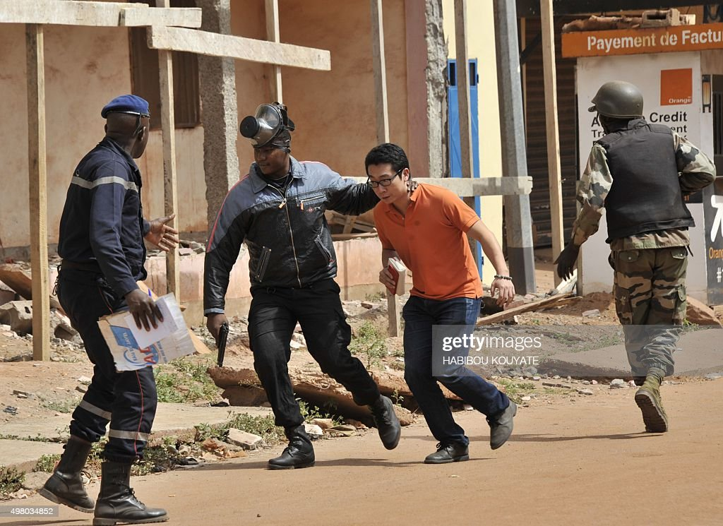 Malian security forces evacuate a man from an area surrounding the Radisson Blu hotel in Bamako on November 20 2015 Gunmen went on a shooting rampage...