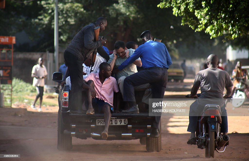 Malian security forces evacuate hostages freed from the Radisson Blu hotel in Bamako on November 20 2015 Gunmen went on a shooting rampage at the...