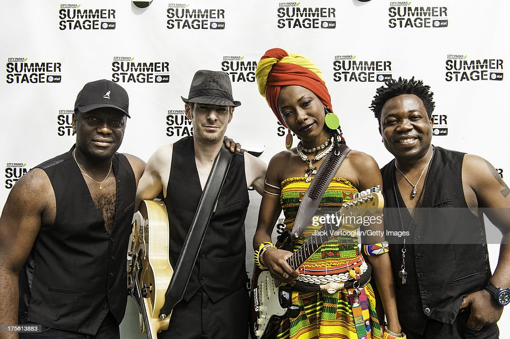 Malian singer and musician <a gi-track='captionPersonalityLinkClicked' href=/galleries/search?phrase=Fatoumata+Diawara&family=editorial&specificpeople=6928565 ng-click='$event.stopPropagation()'>Fatoumata Diawara</a> poses backstage with her band, from left, bassist Jean Alain Hohy, guitarist Greg Emonet, and drummer Jean-Baptiste Ekoue Gbadoe, prior to her performance at Central Park SummerStage, New York, New York, July 21, 2013.