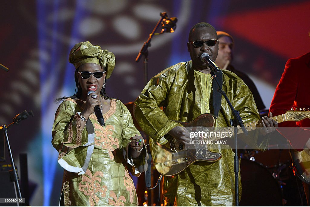 Malian singers Amadou Bagayoko (R) and Mariam Doumbia (L), known as Amadou and Mariam duo perform the song 'Africa mon amour' after receiving the best world music album of the year award for their album 'Folila' during the 28th Victoires de la Musique, the annual French music awards ceremony, on February 8, 2013 at the Zenith concert hall in Paris.