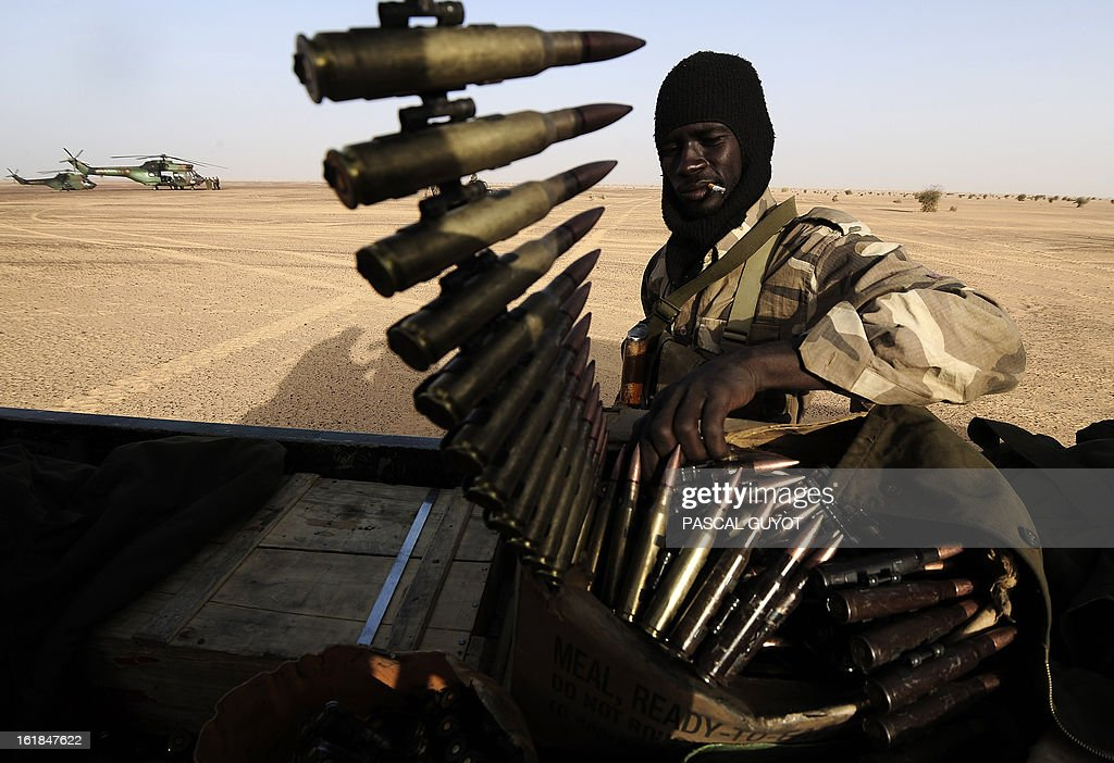 A Malian soldier handles ammunition aboard a vehicle as they enter Bourem northen Mali on February 17, 2013. Leaders in Africa's Sahel region called on Saturday for further efforts to support Mali as they announced new funds to back a West African force in the country. A French-led military intervention launched on January 11 has driven the Islamist rebels in Mali from the towns they controlled, but concerns remain over stability amid suicide attacks and guerrilla fighting. GUYOT