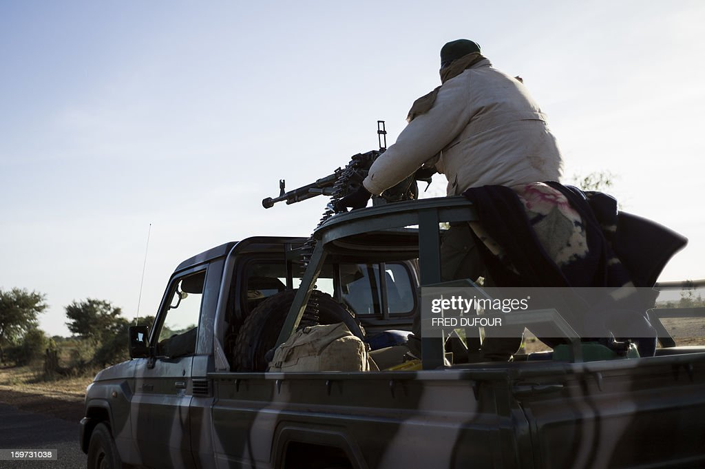 A Malian soldier holds a machine gun in a jeep on the road back from Mopti, on January 19, 2013 in Kongena. West African leaders Saturday sought urgent financial and logistical aid from the United Nations for a regional force in Mali to boost a French-led offensive against Islamists bearing down from the north.