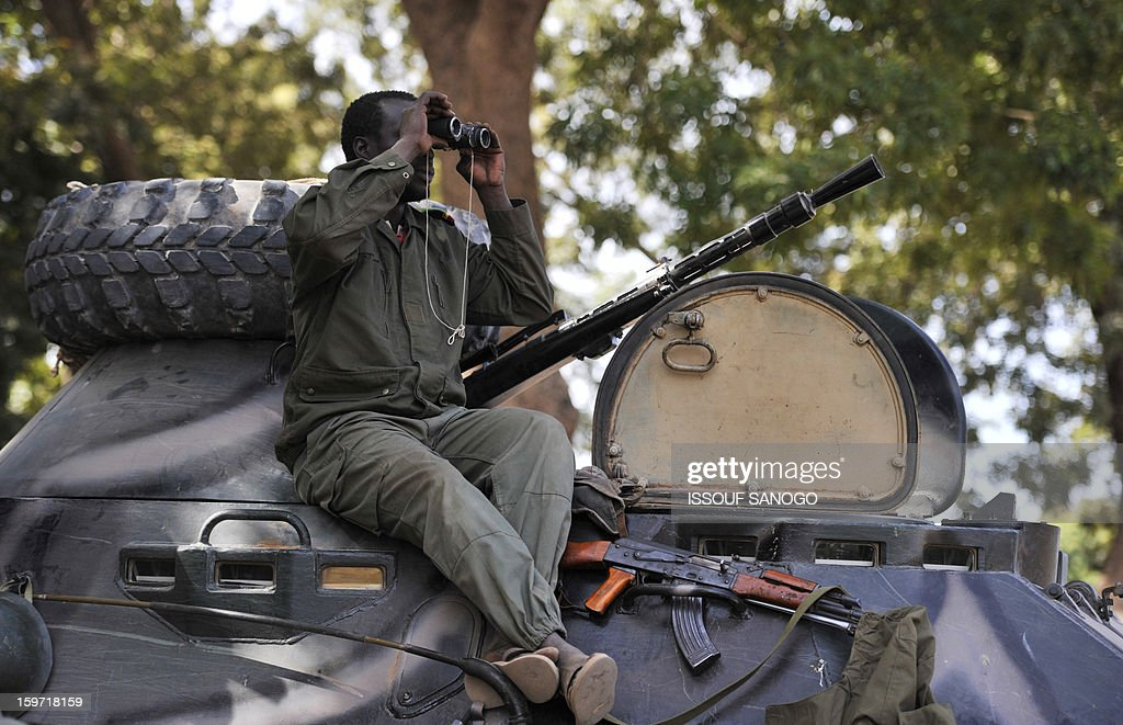 A Malian soldier looks through binoculars, on January 19, 2013, in city of Niono. Ivorian President Alassane Ouattara on January 19 called for a broader international commitment to the military operations in Mali, where Malian and French forces are battling Islamist militant groups that control the country's vast arid north. Some 2,000 members of MISMA (the International Mission for Mali Assistance), the African intervention force, are expected to be deployed by January 26. About 100 soldiers from Togo and Nigeria have already arrived in Bamako, and another 30 or so from Benin are en route to join them.