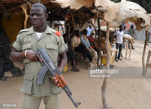 A Malian soldier patrols looking for Islamists on February 12 2013 in the center of the northern Malian city of Gao where the militant group Movement...