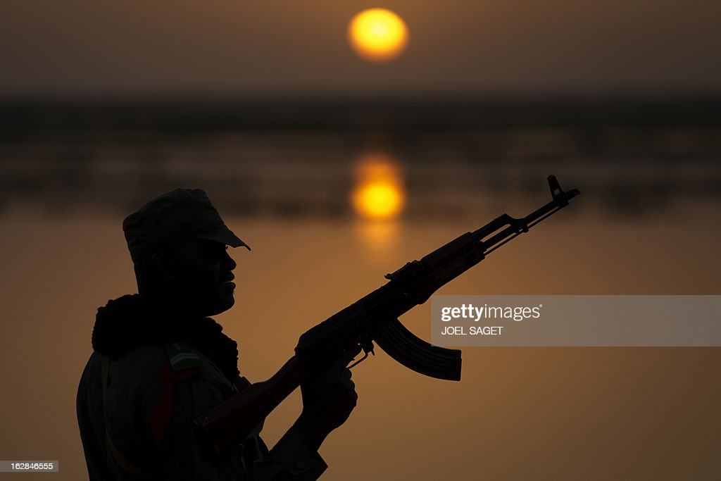 A Malian soldier patrols near the Niger River in the northern city of Gao on February 28, 2013. The Movement for Oneness and Jihad in West Africa (MUJAO) occupied Gao for nine months before it was recaptured by French and Malian troops in a French-led offensive on January 26.