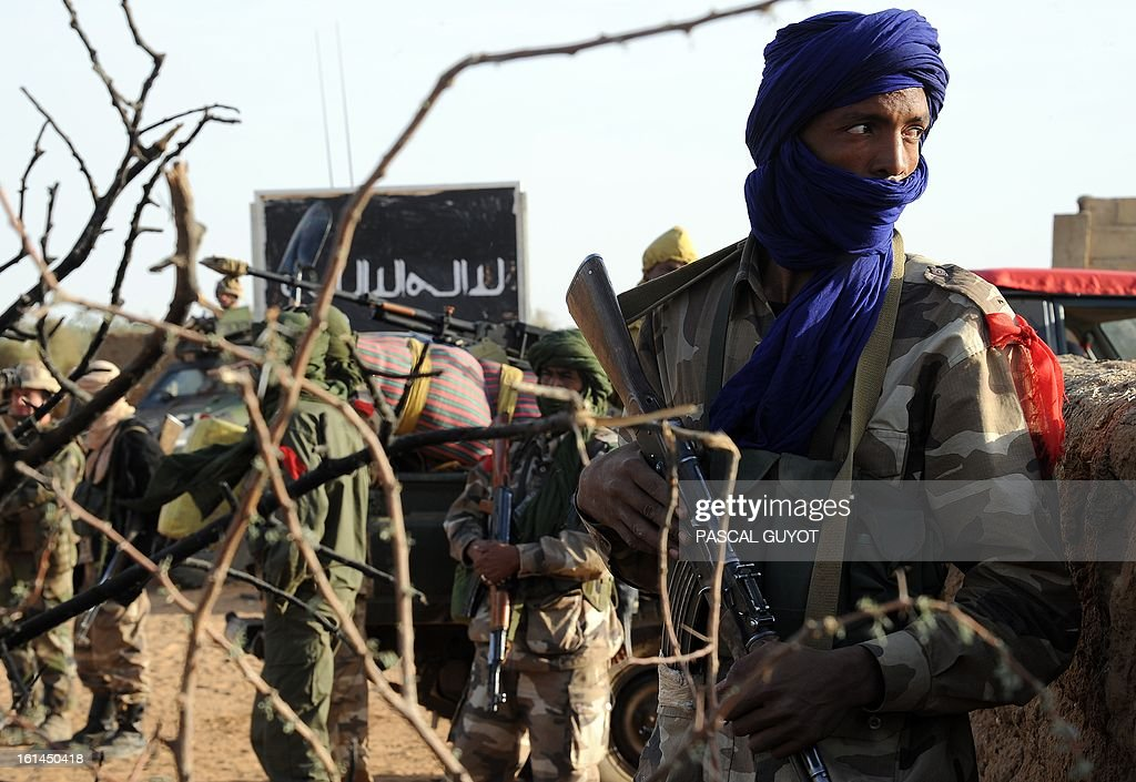 A Malian soldier stands guard at a check-point set on the road leading to Bourem, on February 11, 2013 in Gao, one day after Islamist gunmen battled French and Malian troops following two straight days of suicide bombings.