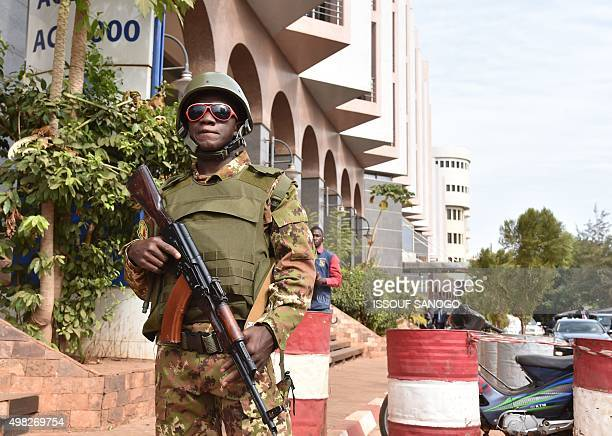 A Malian soldier stands guard outside the Radisson Blu hotel in Bamako on November 22 2015 two days after a deadly attack claimed by AlQaeda...