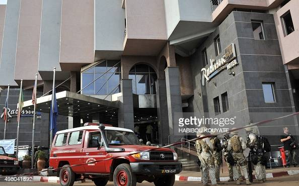 Malian soldiers and special forces stand guard at the entrance the Radisson Blu hotel in Bamako on November 20 after the assault of security forces...