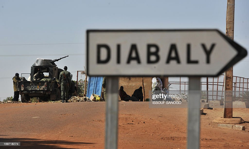 Malian soldiers are deployed at the Diabaly junction, on January 19, 2013, near the city of Niono. Ivorian President Alassane Ouattara on January 19 called for a broader international commitment to the military operations in Mali, where Malian and French forces are battling Islamist militant groups that control the country's vast arid north. Some 2,000 members of MISMA (the International Mission for Mali Assistance), the African intervention force, are expected to be deployed by January 26. About 100 soldiers from Togo and Nigeria have already arrived in Bamako, and another 30 or so from Benin are en route to join them.