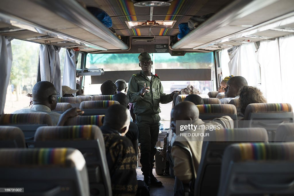 Malian soldiers controls identity of passengers in a bus coming from Mopti, on January 19, 2013 in Kongena. West African leaders Saturday sought urgent financial and logistical aid from the United Nations for a regional force in Mali to boost a French-led offensive against Islamists bearing down from the north. AFP PHOTO / FRED DUFOUR