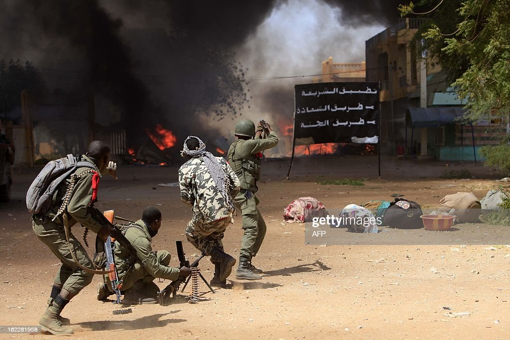 Malian soldiers fight while clashes erupted in the city of Gao on February 21, 2013 and an apparent car bomb struck near a camp housing French troops as Malian and foreign forces struggled to secure Mali's volatile north against Islamist rebels.